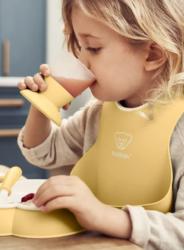 BabyBjorn Нагрудник мягкий с карманом Нежно-желтый